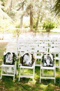 wedding reserved seats for loved ones with their photos