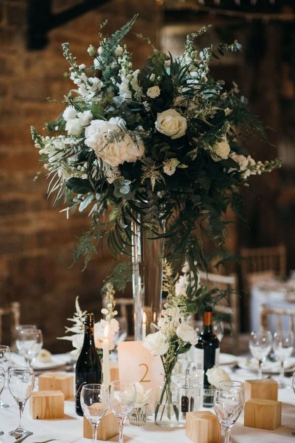 white and green tall floral wedding centrepieces
