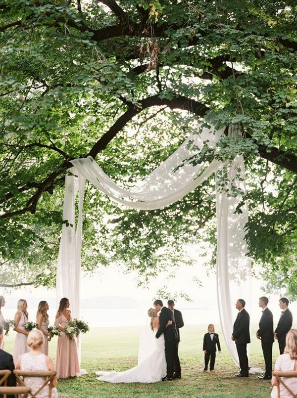 budget friendly drapery wedding arch ideas