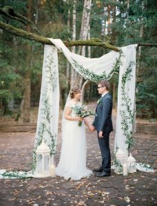 chic greenery and white drapery wedding backdrop ideas