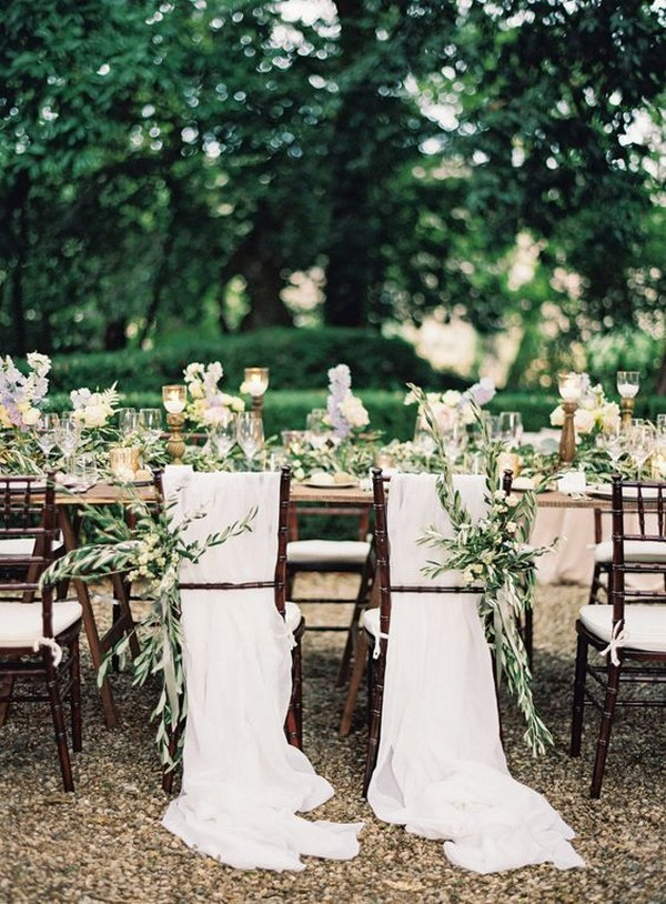chic wedding chair decoration ideas with greenery and drapery