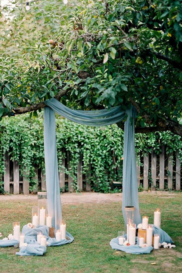 dusty blue wedding arch ideas with candles