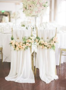 elegant wedding chair decoration ideas with drapery and flowers