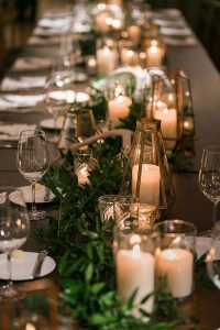 gold and greenery fall wedding centerpiece for long table