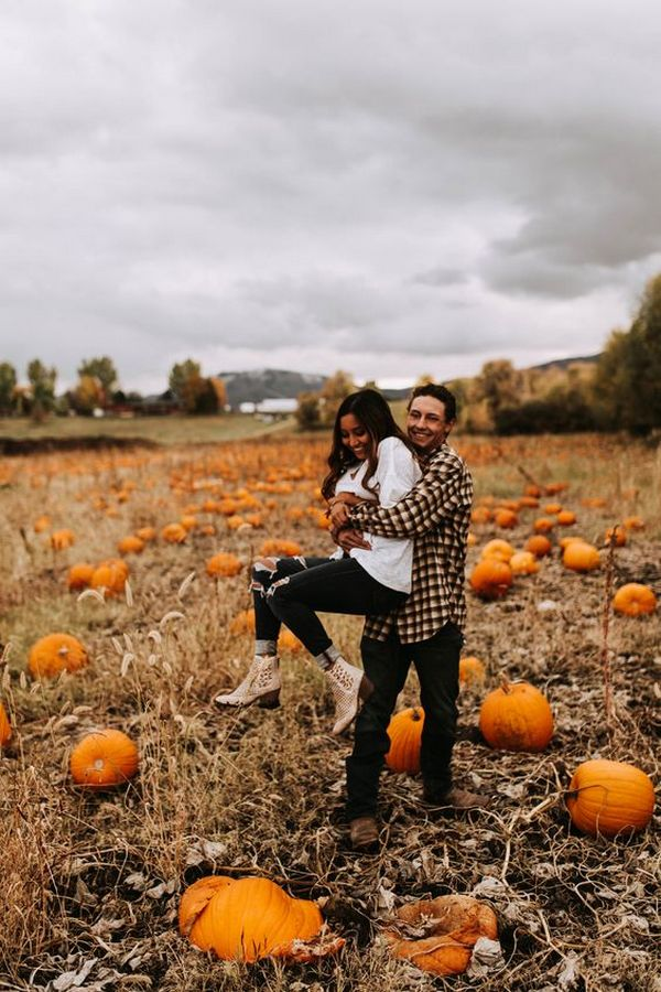pumpkin patch fall wedding engagement photo