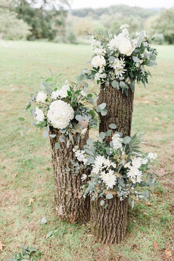 rustic stump and floral accents for wedding ceremony decorations