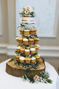 rustic wedding cake with cupcakes