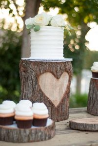 simple rustic wedding cake with cupcakes