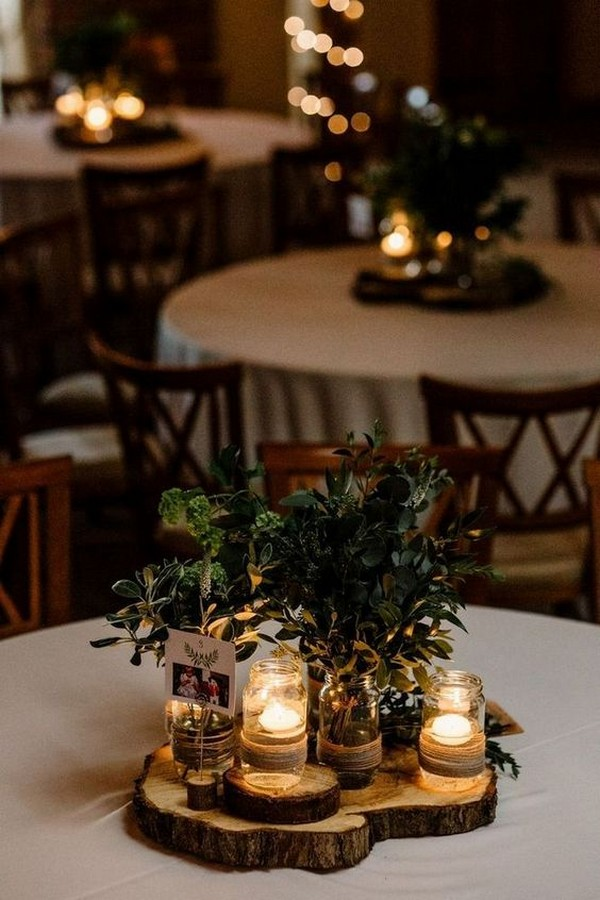 simple rustic wedding centerpieces with candles and greenery