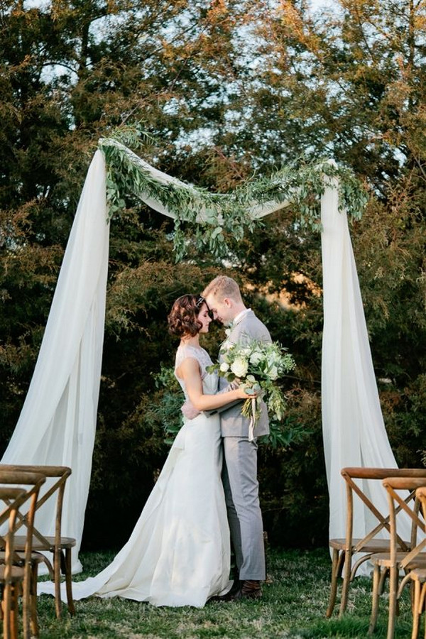 simple wedding arch ideas with white drapery and greenery