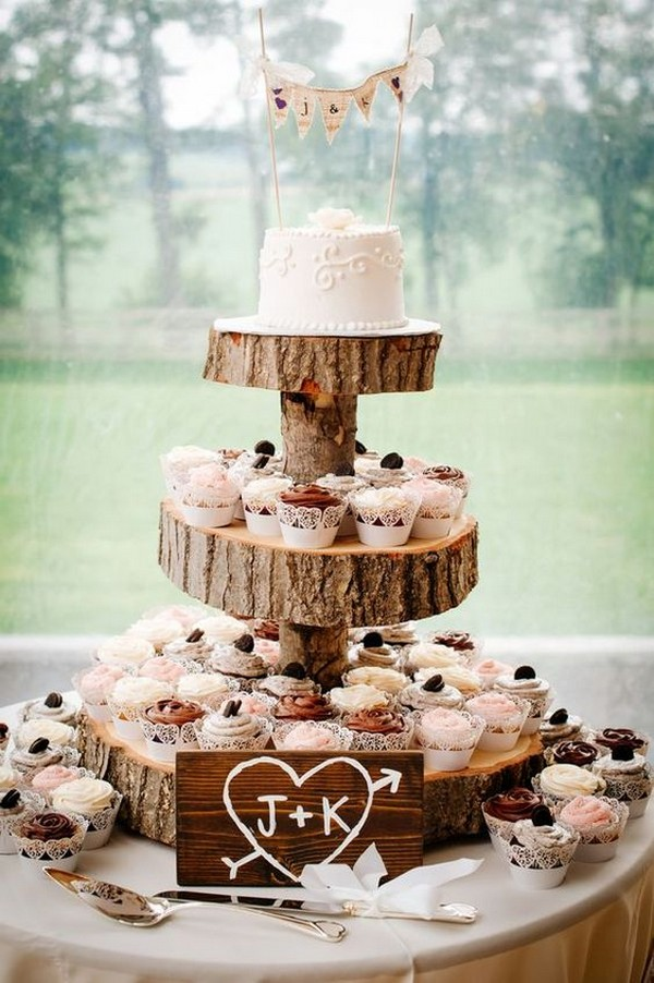 vintage country wedding cake display with cupcakes