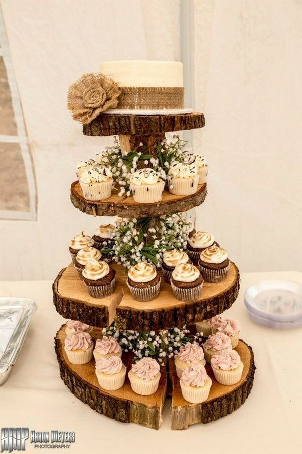 vintage rustic wedding cake with cupcakes