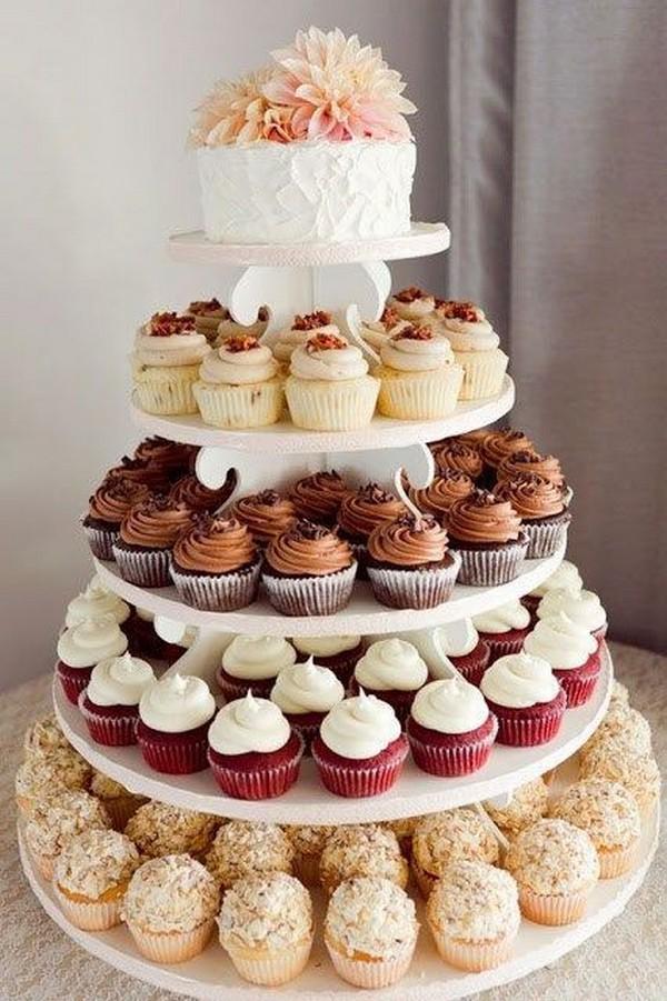 vintage wedding cake with cupcakes