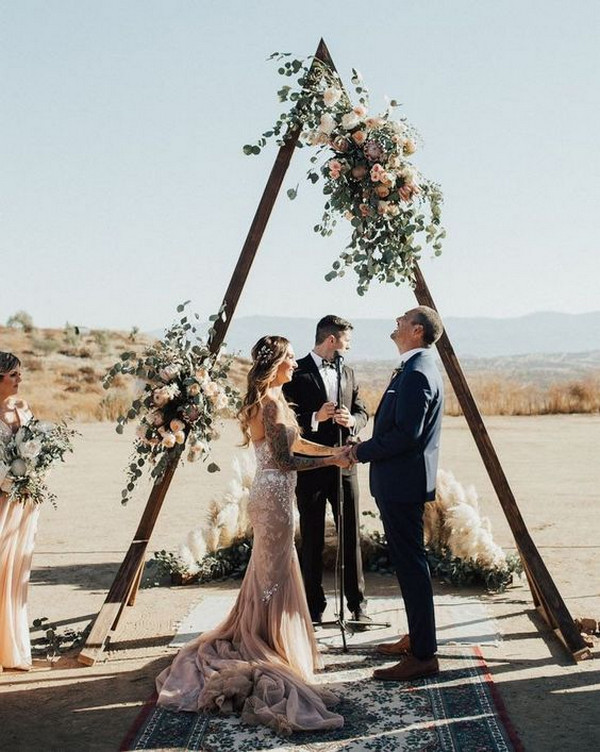 bohemian triangle geometric wedding arch ideas with lush blooms