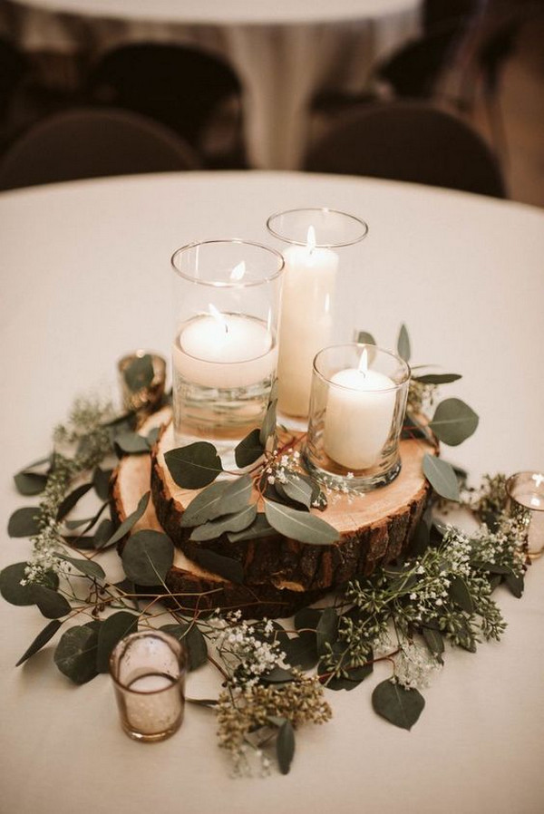 chic rustic winter wedding centerpiece with candle and greenery