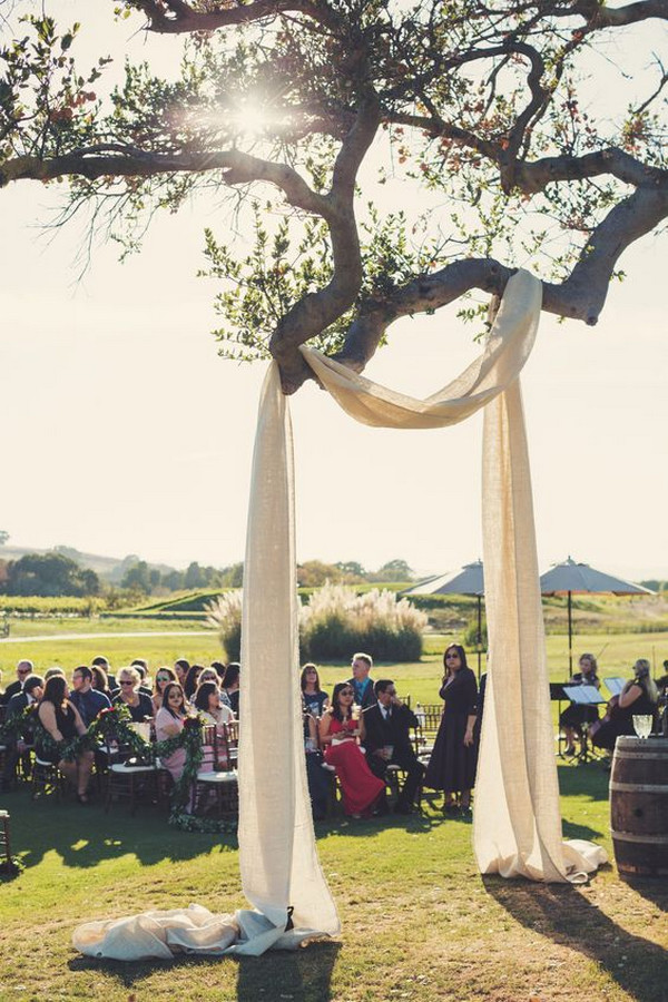 drapery on a tree wedding arch ideas