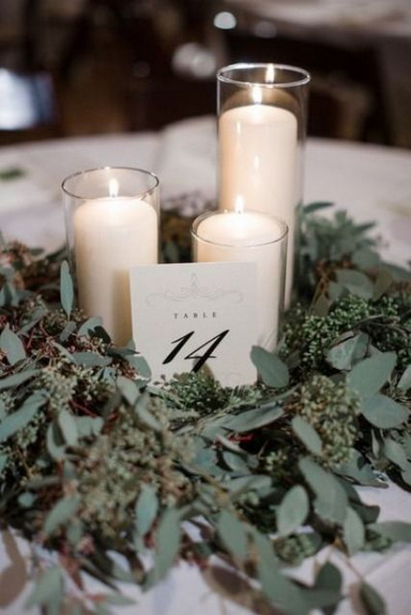 greenery and candles winter wedding centerpiece