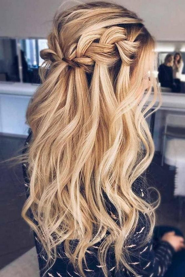 half up half down wedding hairstyle with curls and braid