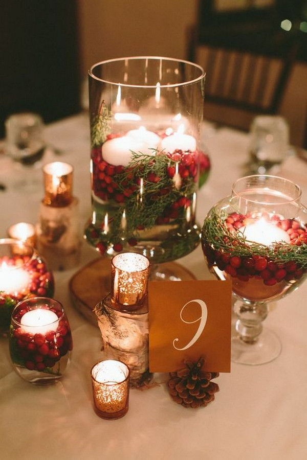 red and green winter wedding centerpiece with candles