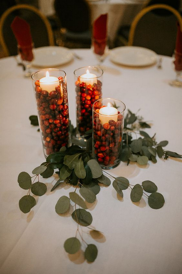 red and green winter wedding centerpiece
