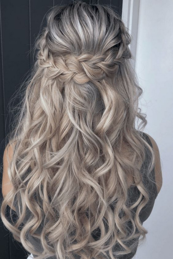 romantic braided half up half down wedding hairstyle