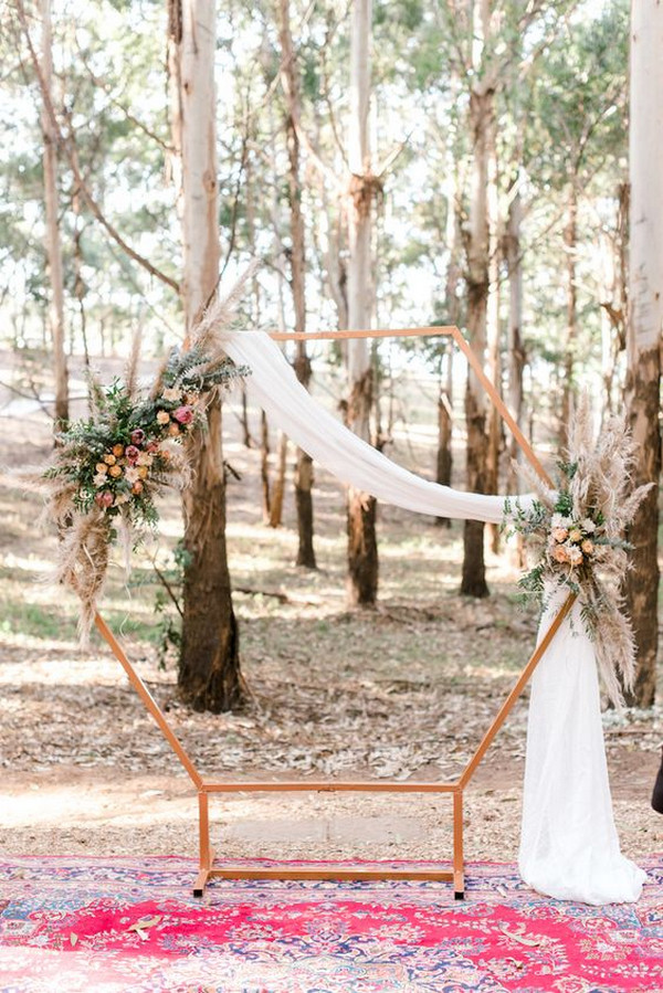 simple geometric wedding arch with pampas grass