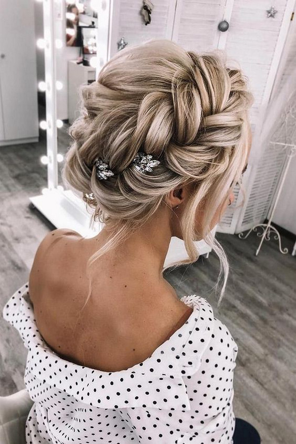 updo wedding hairstyle with trenza crown