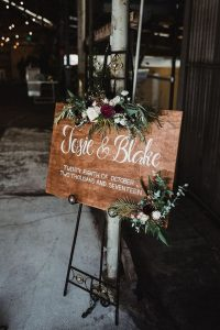 boho wooden wedding welcome sign with floral decorated
