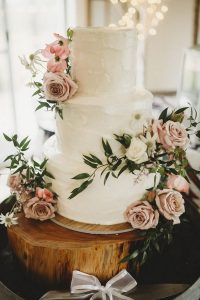 chic rustic wedding cake with dusty rose flowers