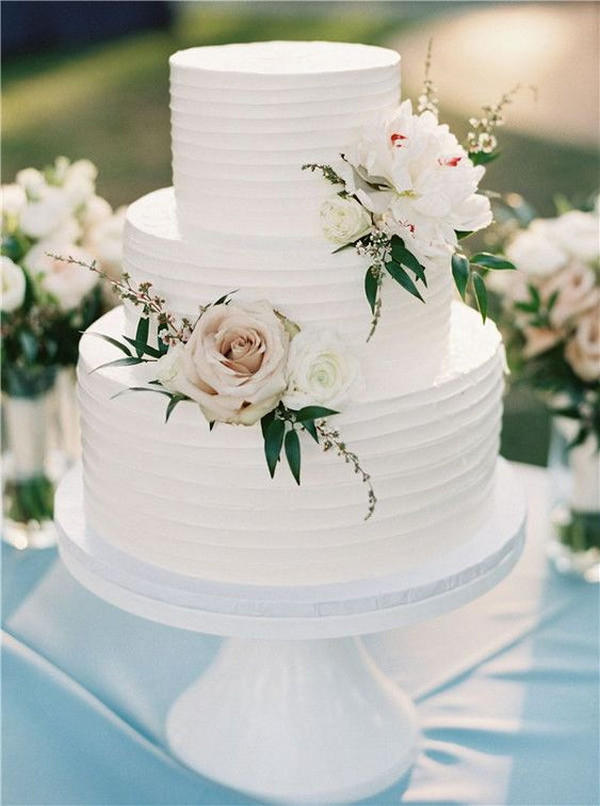 elegant wedding cake with blush floral