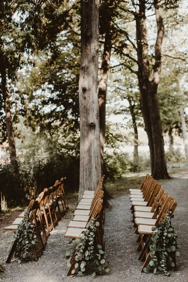 forest wedding aisle ideas with draped greenery