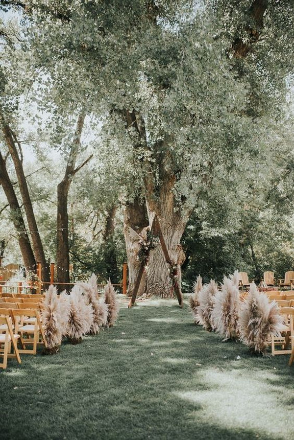 forest wedding ceremony ideas with pampas grass aisle