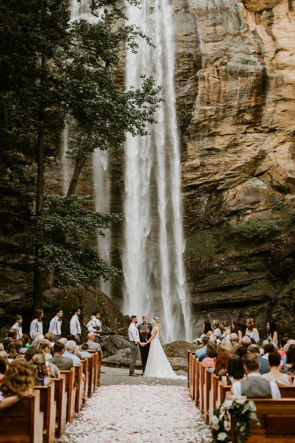 forest wedding ceremony with waterfall backdrop