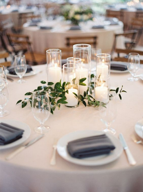minimalist elegant wedding centerpiece with greenery and candles