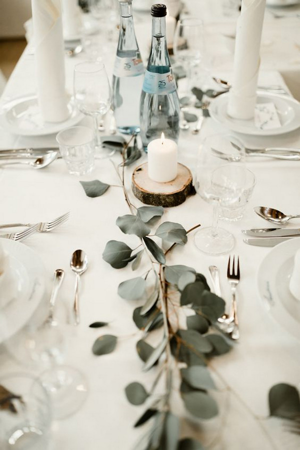 minimalist elegant wedding reception table with greenery