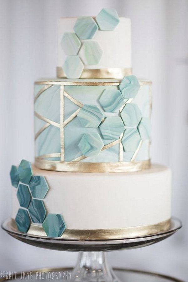 modern shades of blue and metallic gold wedding cake