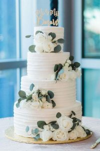 white and green simple elegant spring wedding cake