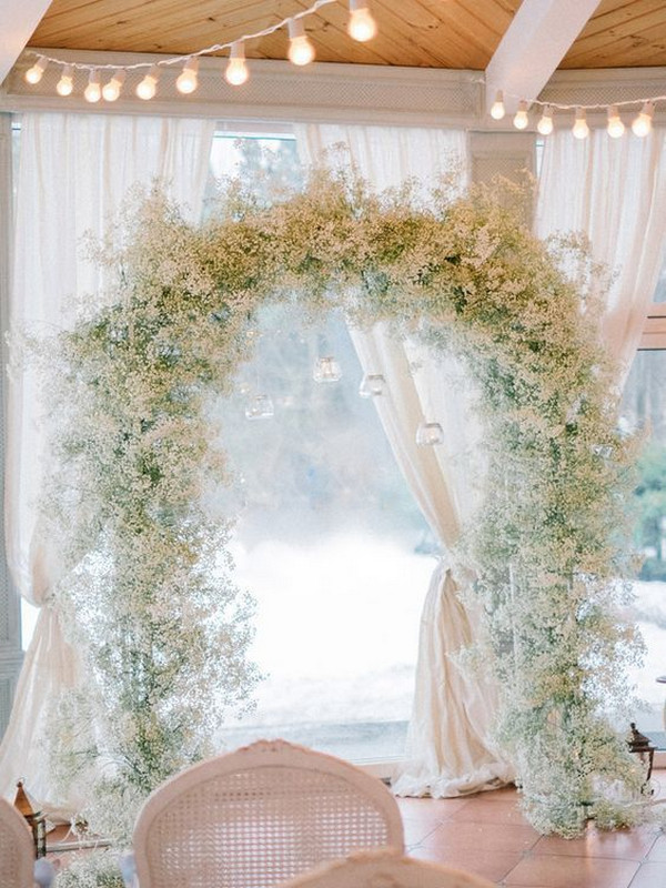 Baby's breath winter wedding arch ideas