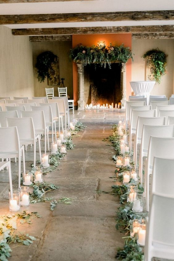 Indoor wedding ceremony with fireplace altar