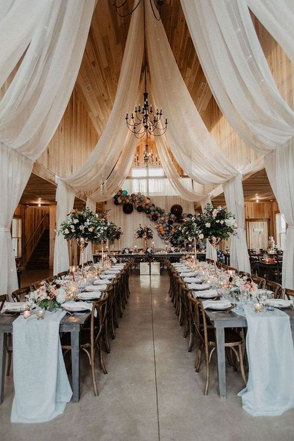 Rustic Chic Wedding Reception Decor with ceiling draping installation