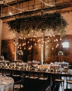 Rustic country barn wedding reception greenery decor