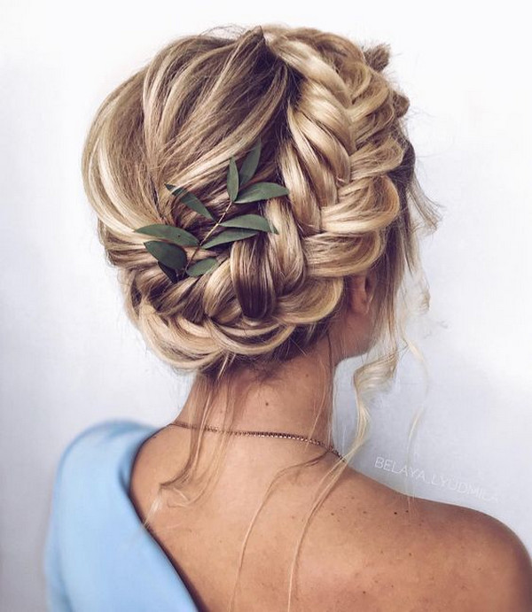 boho braided updo wedding hairstyle with greenery