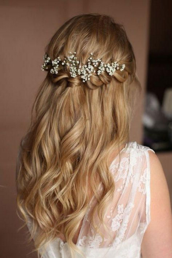 braided half up half down wedding hairstyle with baby's breath