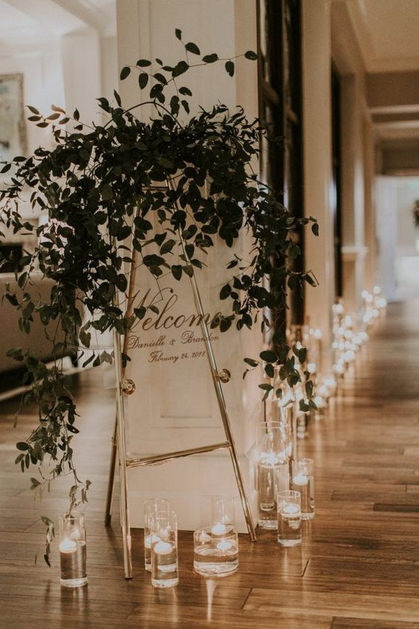 chic acrylic wedding welcome sign ideas decorated with greenery and candles