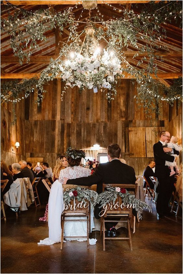 chic rustic barn wedding reception with greenery