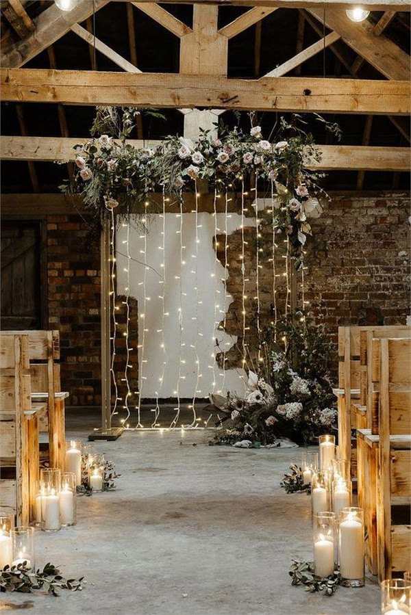 chic rustic indoor wedding ceremony ideas with string lights backdrop