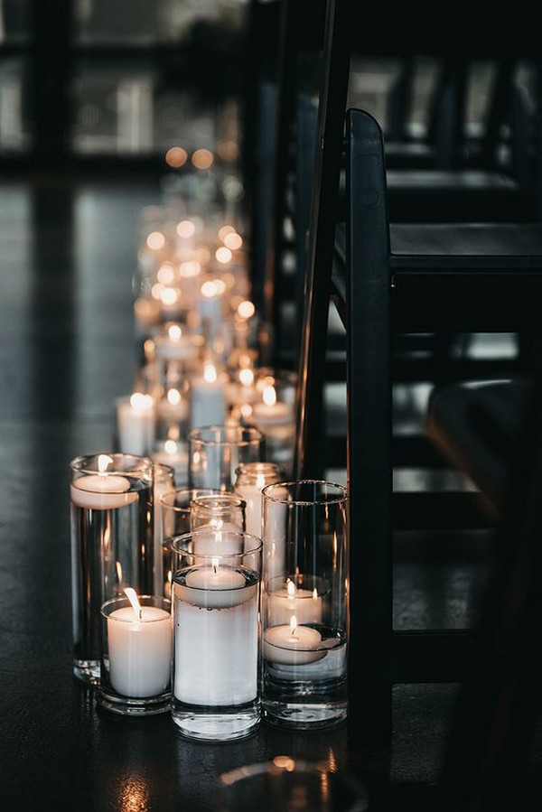 floating candles indoor wedding aisle