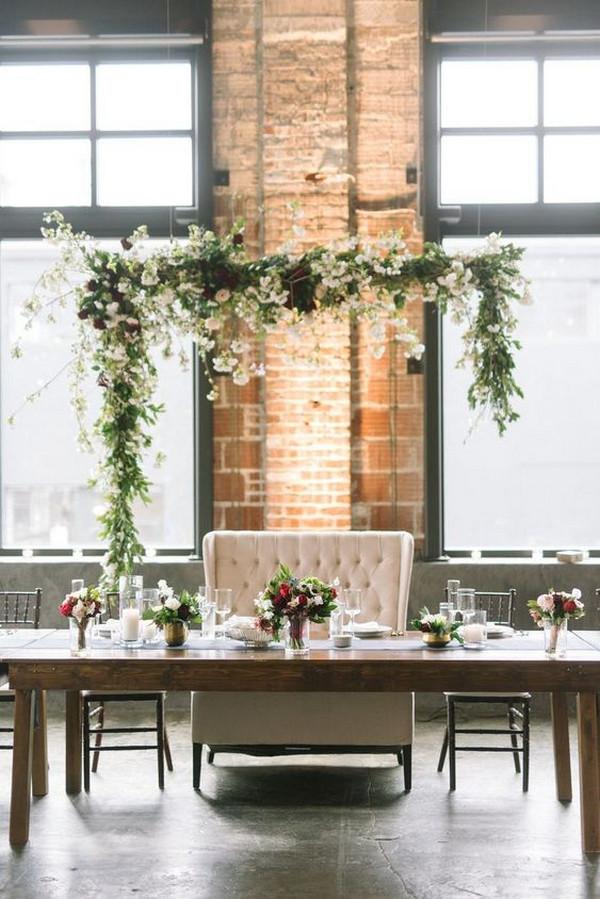 greenery nad cherry blossom wedding head table arch