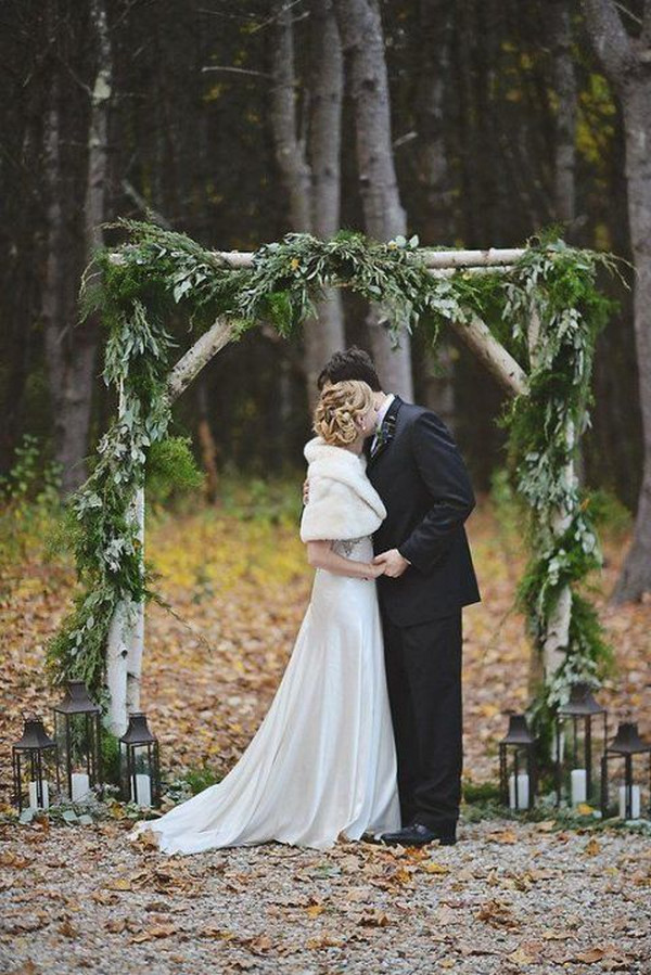 greenery winter wedding arch ideas with ferns