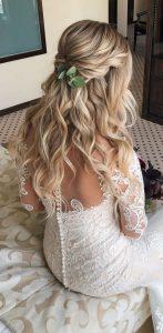 half up half down boho wedding hairstyle with greenery headpiece